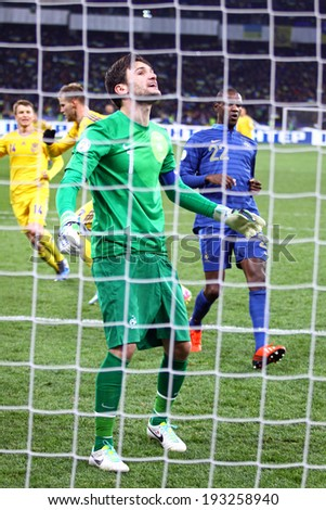 KYIV, UKRAINE - NOVEMBER 15, 2013: Goalkeeper Hugo Lloris of France reacts after missed a goal during FIFA World Cup 2014 play-off game against Ukriane - stock photo