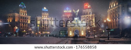 Kyiv, Ukraine - November 10, 2008: New Year in the capital of Ukraine - fog, rain, mist in the air Rare citizens going about their business ancient buildings of Soviet architecture burn advertisement