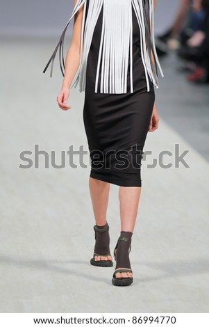 "KYIV, UKRAINE - OCT. 14: Model walks the runway during Fashion Show by ""LITKOVSKAYA"" as part of Ukrainian Fashion Week, October 14, 2011 in Kyiv, Ukraine."