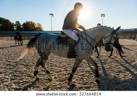 KYIV, UKRAINE - OCTOBER 10, 2015: A participant of competitions in jumping demonstration during international equestrian tournamentt - stock photo