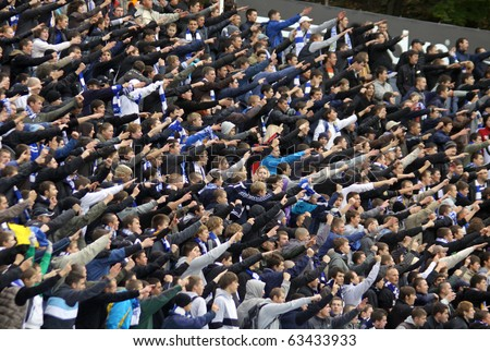 KYIV, UKRAINE - OCTOBER 16: FC Dynamo Kiev team supporters show their support during Ukraine Championship game against FC Karpaty Lviv on October 16, 2010 in Kyiv, Ukraine - stock photo