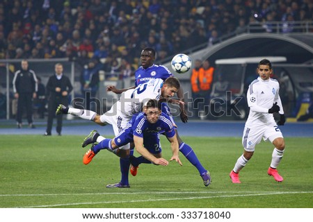 KYIV, UKRAINE - OCTOBER 20, 2015: FC Dynamo Kyiv players (in white) fight for a ball with Chelsea players (Blue) during their UEFA Champions League game at NSC Olimpiyskyi stadium in Kyiv - stock photo