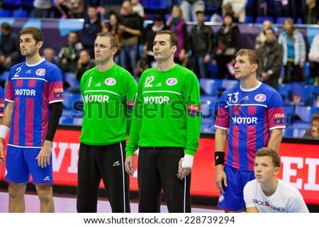 KYIV, UKRAINE - OCTOBER 18, 2014: Handball players of team Motor listen the anthem before European Handball Champions League game against Aalborg - stock photo