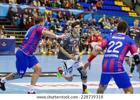 KYIV, UKRAINE - OCTOBER 18, 2014: Martin Larsen of Aalborg (C) controls a ball during European Handball Champions League game against Motor - stock photo