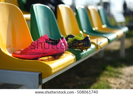 KYIV, UKRAINE - 31 OCTOBER 2016: Nike Mercurial Victory football boots. Used shoes placed on substitution bench after training practice. Lightweight synthetic leather upper for better ball control