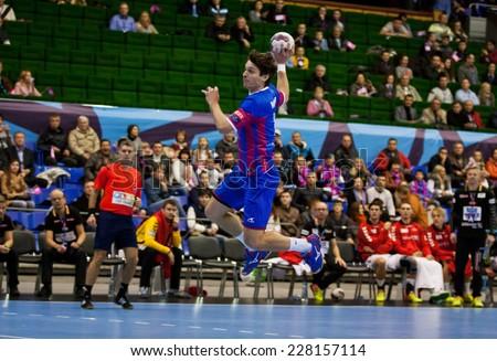 KYIV, UKRAINE - OCTOBER 18, 2014: Oleg Skopintsev of Motor attacks during European Handball Champions League game against Aalborg - stock photo