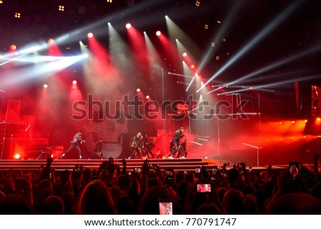KYIV, UKRAINE - OCTOBER 27, 2017: Singer Max Barskih (Mykola Bortnyk) during a performance at a concert in the Sports Palace, with a big skull on the stage
