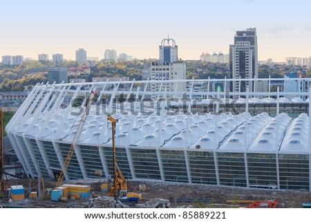KYIV, UKRAINE - OCTOBER 2: The construction works of Kyiv's Olympic stadium for football UEFA EURO 2012 . October 2, 2011 in Kiev, Ukraine - stock photo