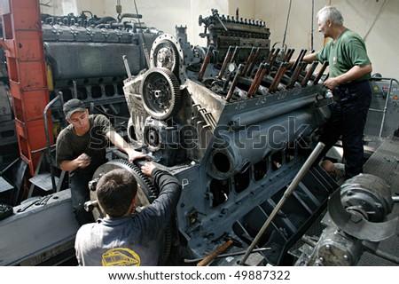 "KYIV, UKRAINE - SEP 08:  Worker at Poltava ""Diesel Locomotive Plant"" during open doors day on September 08, 2009 in Polava, Ukraine - stock photo"