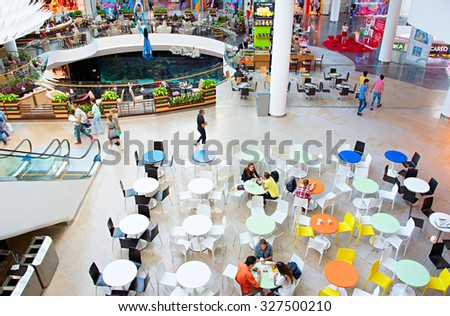 KYIV, UKRAINE - SEPT 22, 2015: People at Ocean Plaza shopping mall in Kyiv. Ocean Plaza is the second largest shopping mall and entertainment complex of Kyiv. - stock photo