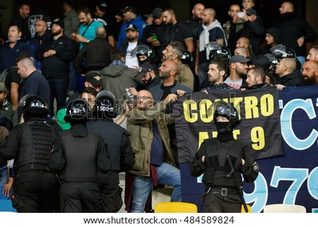 KYIV, UKRAINE - SEPT 13, 2016: SSC Napoli supporters and riot police during UEFA Champions League game against FC Dynamo Kyiv at NSC Olympic stadium
