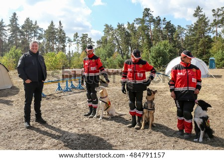 KYIV, Ukraine - Sept. 18, 2016: The Rescuers' Day in Ukraine. The Interior Minister posing with the dogs handlers of the Rescue Department.