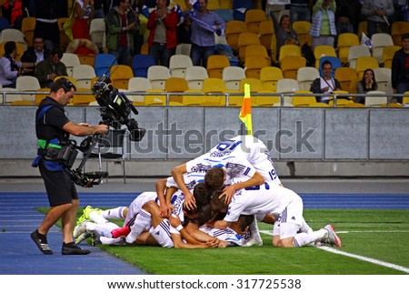 KYIV, UKRAINE - SEPTEMBER 16, 2015: FC Dynamo Kyiv players react after score a goal during UEFA Champions League game against FC Porto at NSC Olimpiyskyi stadium - stock photo