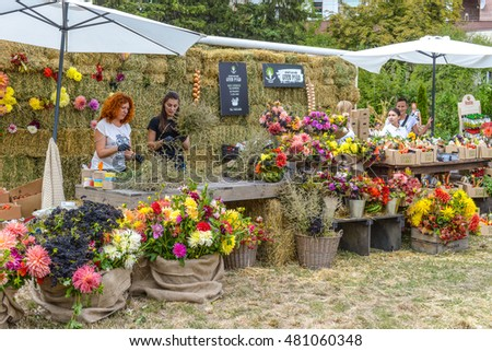 KYIV, UKRAINE - SEPTEMBER 10, 2016: Local producers at the farmers market of good food, vegetables, herbs, berries, honey, etc. Big farmer's market of healthy food was organized by Good Wine Company.