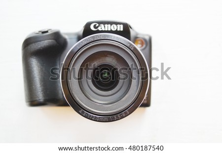 KYIV, UKRAINE - 08 September, 2016: Small digital Canon camera with big lens isolated over white background