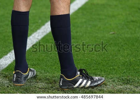 KYIV, UKRAINE - SEPTEMBER 13, 2016: Soccer referee walks on the pitch during during UEFA Champions League game FC Dynamo Kyiv vs SSC Napoli at NSC Olympic stadium in Kyiv