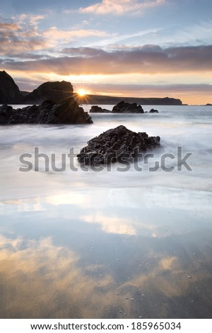 Kynance Cove is a cove in southwest Cornwall, United Kingdom being situated on the Lizard peninsula approximately two miles north of Lizard Point. Kynance Cove is owned by the National Trust.  - stock photo