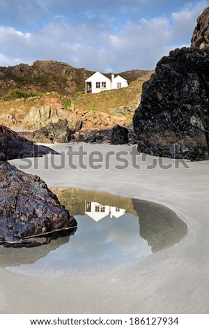 Kynance Cove is a cove in southwest Cornwall, United Kingdom being situated on the Lizard peninsula approximately two miles (3 km) north of Lizard Point.  - stock photo