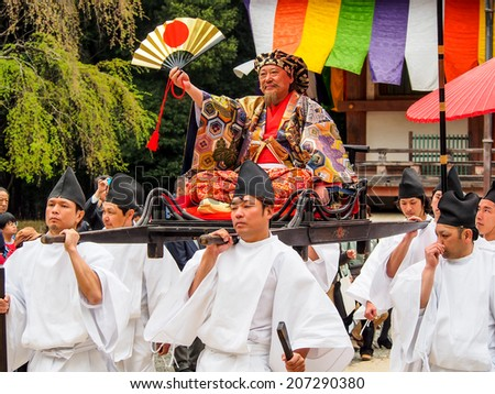 KYOTO -APR 13: Unidentified performers of spring festival at Daigo-ji temple on April 13, 2014 in Kyoto, Japan. Japanese festivals are usually sponsored by a local shrine or temple. - stock photo