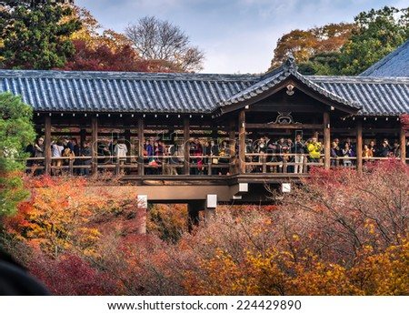 KYOTO - 1 DECEMBER 2013: Crowds gather at Tofukuji Temple to celebrate the autumn maple leave festival in Kyoto, Japan. - stock photo