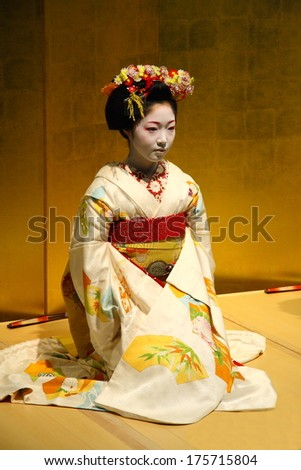 KYOTO - JAN 10: Beautiful nidentified Geisha in a traditional room during a ceremony in Gion district of Kyoto, Japan on January 10, 2010. Geishas are girls skilled in traditional Japanese arts. - stock photo