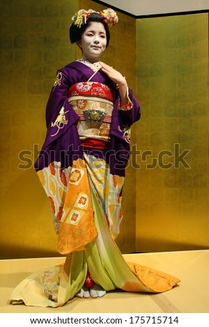 KYOTO - JAN 10:Beautiful unidentified Geisha in a traditional room during a ceremony in Gion district of Kyoto, Japan on January 10, 2010. Geishas are girls skilled in traditional Japanese arts. - stock photo