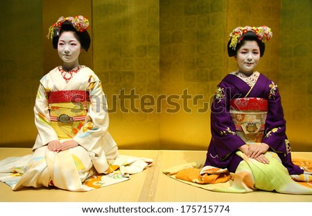 KYOTO - JAN 10: Two unidentified Geishas sitting on tatami in during a ceremony in Gion district of Kyoto, Japan on January 10, 2010. Geishas are girls skilled in traditional Japanese arts. - stock photo