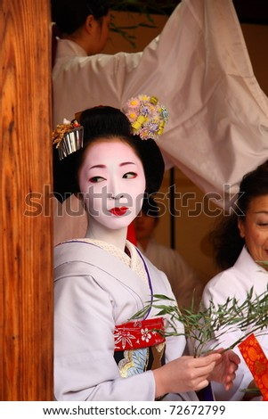 KYOTO - JAN 11: Unidentified geisha participates on a traditional New Year ceremony held on January 11 2010 in Gion district, Kyoto, Japan .The ceremony takes in an ancient Shinto Temple. - stock photo