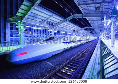 KYOTO - JANUARY 28: Japan's Bullet Train makes a brief stop January 21, 2013 in Kyoto, JP. The Tokkaido Shinkansen is the world's busiest high-speed rail line carrying 151 million passengers annually. - stock photo