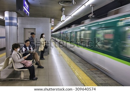 KYOTO, JAPAN - APRIL 18, 2012: People wait at Keihan Railway Station in Kyoto, Japan. Keihan Railway company was founded in 1949 and is among busiest in Japan.