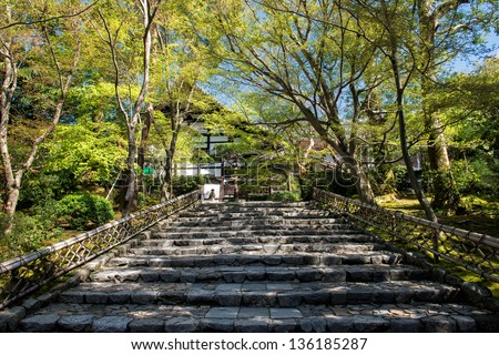 KYOTO, JAPAN - APRIL 8: Stairway to the famous Zen garden at Rioan-ji Temple on April 8, 2013 in Kyoto. The temple from the 15th century is a UNESCO World Heritage site.