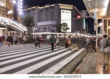 KYOTO, JAPAN - APRIL 16, 2012: Visitors shop at Shijo Street in Kyoto. With famous Marui and Takashimaya department stores Shijo is the best shopping area in Kyoto (according to Japan Guide). - stock photo