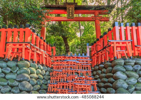 KYOTO, JAPAN -APRIL 15, 2015: Wishing Wooden Torii at Fushimi Inari Taisha Shrine, the head shrine of Inari including trails up the mountain in Kyoto, Japan.