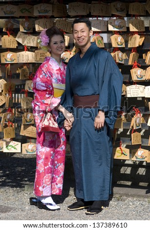 KYOTO, JAPAN - APRIL 4: Young couple in traditional kimono at April 4, 2013 in Kyoto, Japan. Kimono, the national Japanese dress is still worn in Kyoto, as it is the cultural center of Japan.
