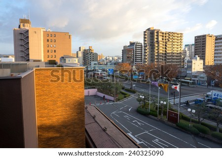 KYOTO, JAPAN - DECEMBER 03, 2014: Low-rise buildings dot the skyline of Kyoto. Environment laws and earthquakes limit the height of buildings here. - stock photo