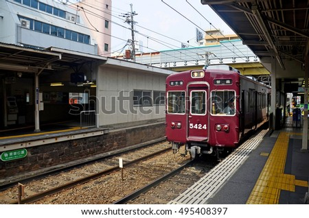 KYOTO, JAPAN - JULY 12 : Red classic train of Hankyu kyoto line running from Kyoto station go to Numba station at Osaka on July 12, 2015 in Kyoto, Japan