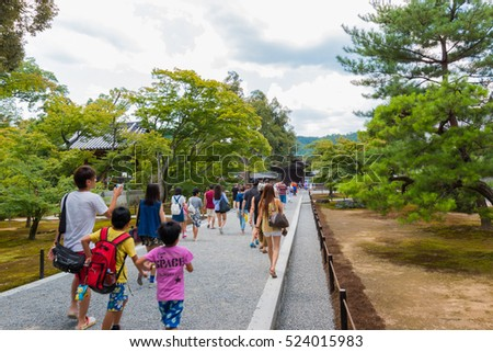 KYOTO, JAPAN - July 31, 2016: The Tourists visit Kinkaku-ji temple  It is a Zen Buddhist temple in Kyoto, Japan. the garden complex is an excellent example of Muromachi period garden design.