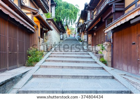 KYOTO, JAPAN - JUNE 15, 2015: Empty stone steps leading up path with old traditional tourist restaurants and shops including famous Sannen-zaka sweets  - stock photo