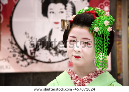 KYOTO, JAPAN - June 16 2016: Geisha on the streets of Gion. In Kyoto, Japan 2016 - stock photo