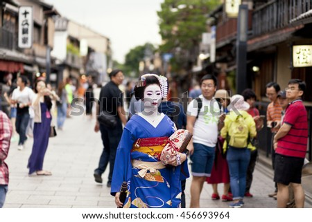 KYOTO, JAPAN - MAY 26,2016: Maiko in kimono performs in Gion district on May 26, 2016 in Kyoto, Japan. Maiko is a geisha apprentice, left from the medieval times. - stock photo
