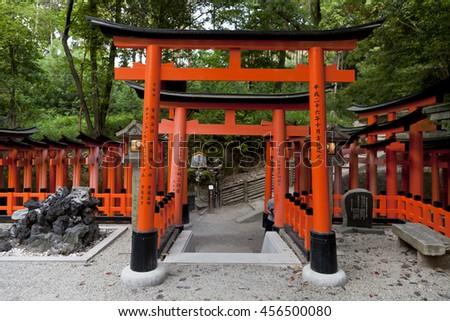 KYOTO,JAPAN- MAY 23, 2016: Red Torii gates in Fushimi Inari shrine, one of famous landmarks in Kyoto, Japan - stock photo