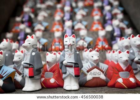 KYOTO,JAPAN- MAY 23, 2016: Statue Of The Inari- fox at Fushimi Inari shrine, one of famous landmarks in Kyoto, Japan - stock photo