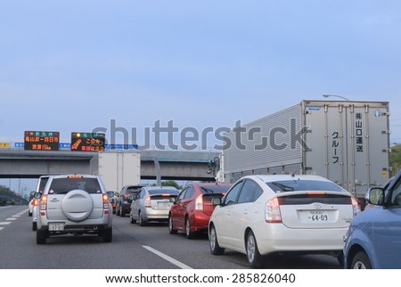 KYOTO JAPAN - MAY 6, 2015: Traffic jam due to accident in Meishin highway. Japanese highway system including tunnel and bridge extends all over Japan.   - stock photo