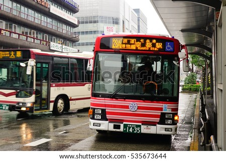 Kyoto, Japan - Nov 27, 2016. A bus stopping at station in Kyoto, Japan. The Kyoto City Buses are major mean of public transport in Kyoto. The buses have been operating since 1928.