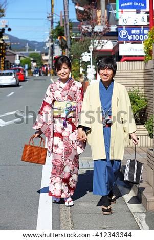 KYOTO, JAPAN - Nov 4: Unidentified Young japanese yukata couple walking on road near Togetsukyo bridge in autumn on November 4, 2015 in Kyoto, Japan. Arashiyama is a place of popular tourist spot  - stock photo