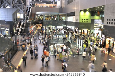 KYOTO,JAPAN-NOVEMBER 9, 2014; Kyoto station building with shops and entrances to the railway and subway station with passengers on the move. November,9,2014 Kyoto, Japan - stock photo