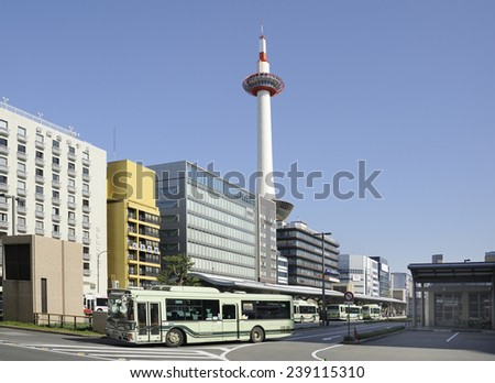 KYOTO,JAPAN-NOVEMBER 11, 2014 Kyoto Tower and bus station in the citycenter at daytime with clear blue sky.November 11, 2014 Kyoto, Japan - stock photo
