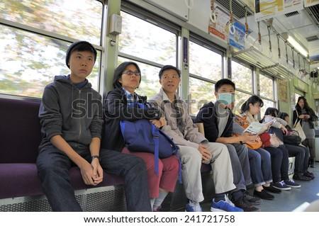 KYOTO, JAPAN- NOVEMBER 10, 2014; People ride in the subway.November 10, 2014 Kyoto, Japan - stock photo