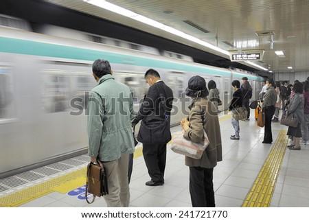 KYOTO,JAPAN-NOVEMBER 10; People wait at Karasuma Oike Subway Station on November 10, 2014 Kyoto, Japan.  - stock photo