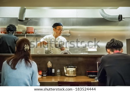 KYOTO, JAPAN - NOVEMBER 20: Ramen restaurant in Kyoto, Japan on November 20, 2013. Unidentified Japanese Ramen chefs prepare a bowl of ramen noodle for customers